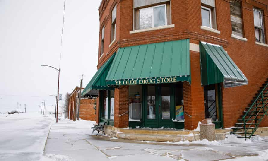 Drug store on snowy street