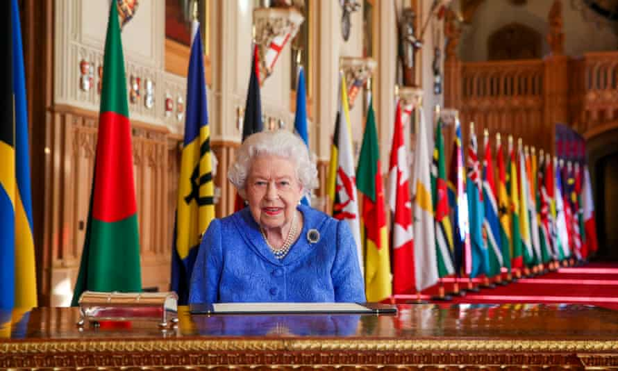 The Queen signs her annual Commonwealth day message at Windsor Castle in March.