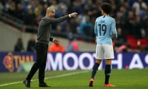 Pep Guardiola instructs Leroy Sané during a match