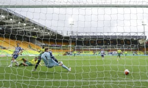 Leandro Trossard slots the ball across Norwich's Tim Krul to open the scoring for Brighton.