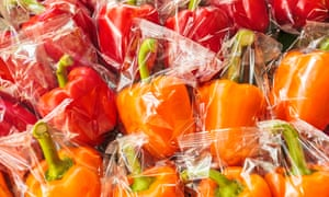 Plastic wrapped orange and red capsicum
