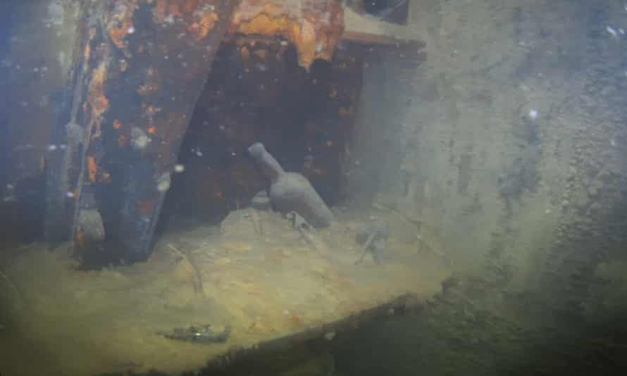Bottles and other artifacts sit on a shelf in a cabin on the lower deck of HMS Terror.