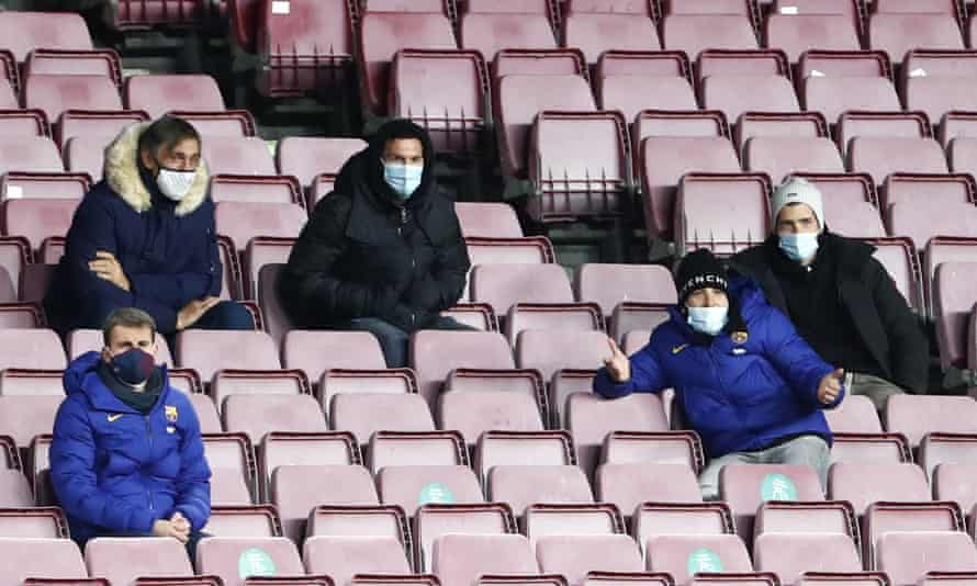 Lionel Messi (centre) watches on from the stands.