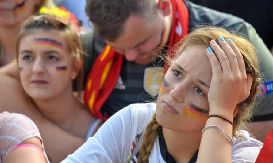 Dejected Germany fans the Fanmeile in Berlin watch as their team is dumped out of the tournament.