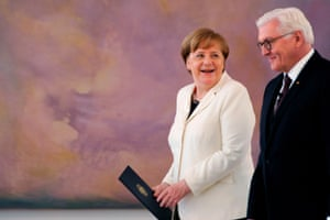 President Frank-Walter Steinmeier Chancellor Angela Merkel share a moment during the hand over ceremony of the certificate of appointment at the Bellevue Palace