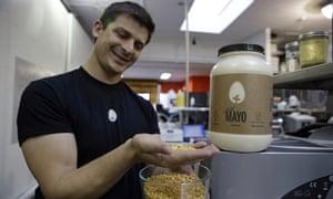 Hampton Creek CEO Josh Tetrick with yellow peas used to make Just Mayo