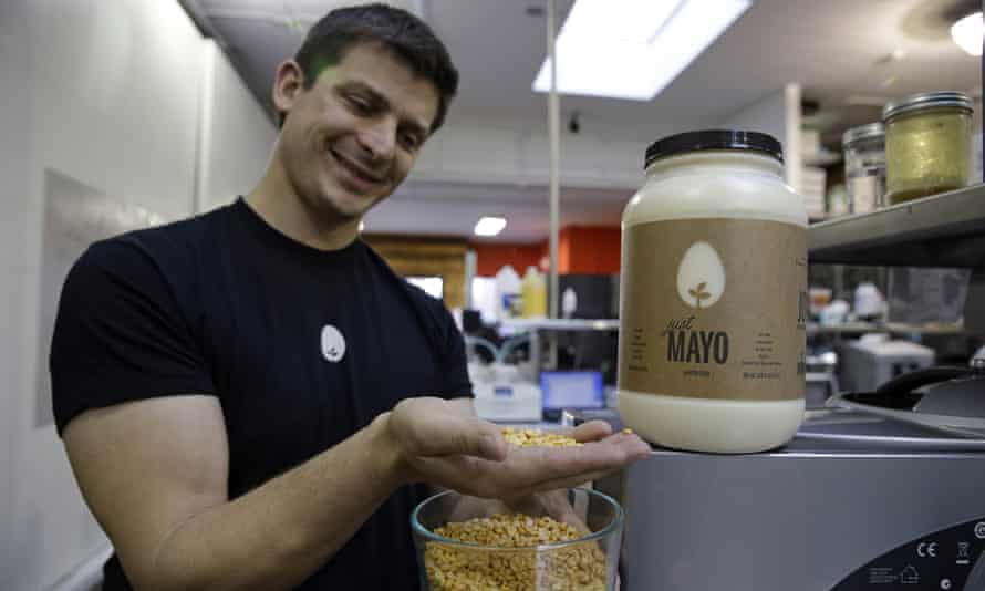 Hampton Creek CEO Josh Tetrick with yellow peas used to make Just Mayo