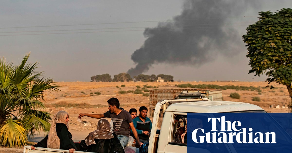 Turkish troops advance into Syria as Trump washes his hands of the Kurds