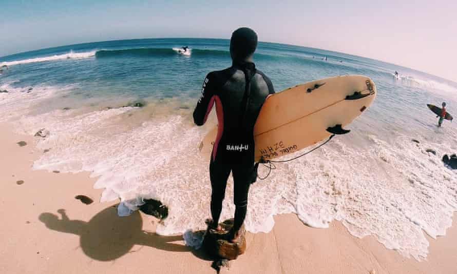Surf's up: a Bantu boarder gets ready to head out into the sea.