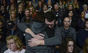 Students from School Highlands Ranch at a candlelight vigil, following a shooting in which one student died.