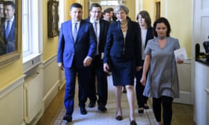 Stanislav Yezhov stands between Volodymyr Groysman and Theresa May in July 2017