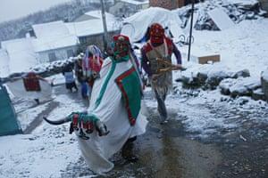 Performers parade during La Talanquera festival in San Martin de Castaneda, Zamora