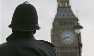 Police officers secure parliament square near the landmark Big Ben's clock tower in London