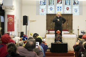 A clown performs during the annual Grimaldi Memorial Service at the All Saints church in east London