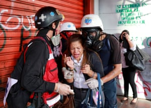 Caracas, Venezuela A woman overcome by teargas receives assistance from volunteer members of a primary care response team during a rally against President Nicolás Maduro's government