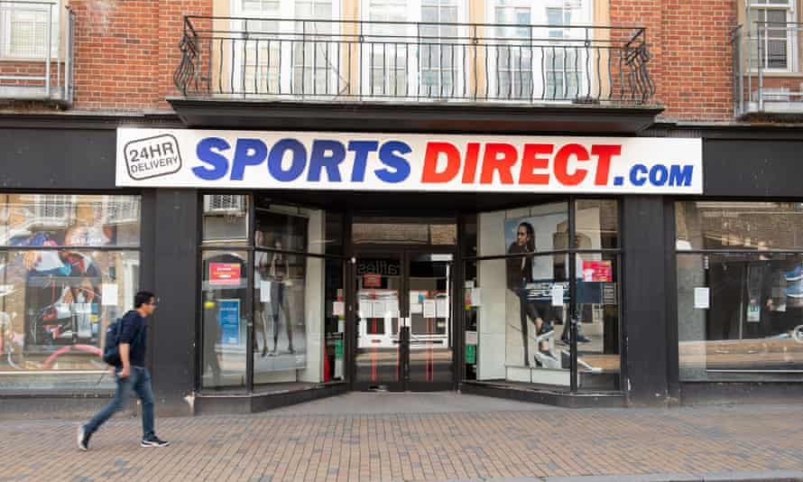 A man walks past a closed Sports Direct store
