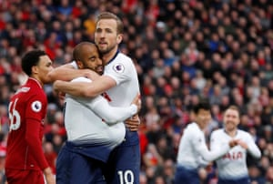 Moura celebrates with Kane.