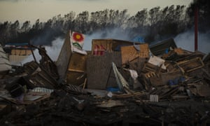 Destroyed tents and structures in the camp.