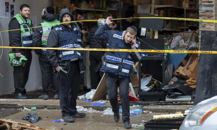 Responders work to clean up the scene of Tuesday's shooting that left multiple people dead at a kosher market in Jersey City, New Jersey.