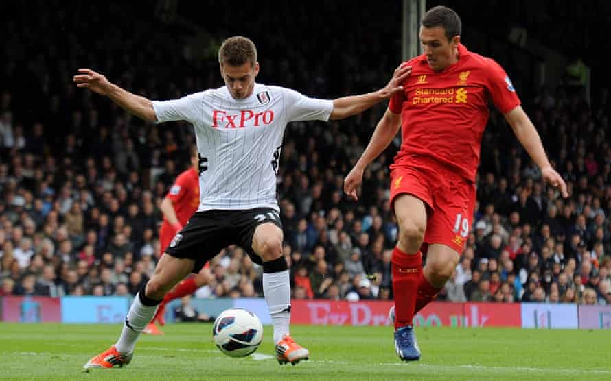 Fulham's Alex Kacaniklic holds off Stewart Downing of Liverpool at Craven Cottage in May 2013.