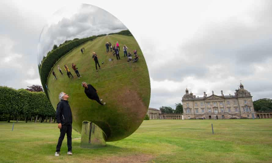Anish Kapoor with his sculpture Sky Mirror, at Houghton Hall, King's Lynn, Norfolk