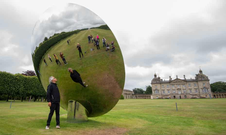 Anish Kapoor exhibitionArtist Anish Kapoor looks into his sculpture Sky Mirror' at Houghton Hall, King's Lynn, ahead of the opening of his largest UK exhibition of outdoor sculptures.
