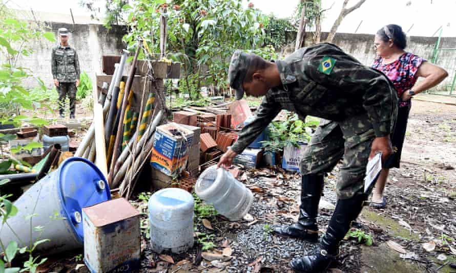 Armed forces members check a house for mosquito breeding areas in a rural area in Brazlândia, 45km northwest of Brasília.