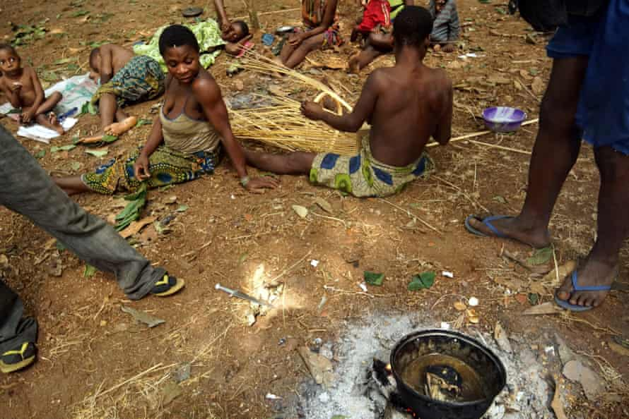 In the Central African Republic's Sangha forest, poachers cook a monkey head at a Baka forest Pygmy camp