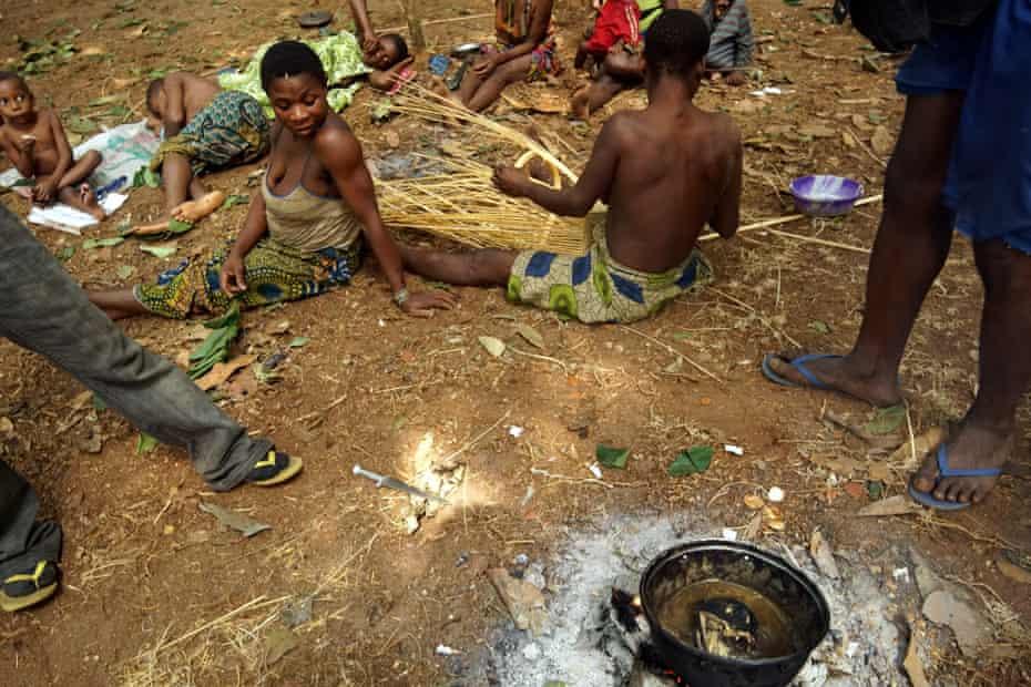 Poachers cook a monkey's head at the Ba'aka camp