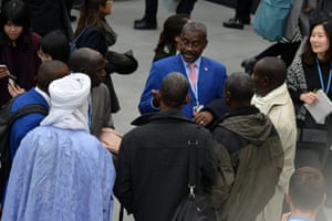 Members of an African country's delegation chat at the conference