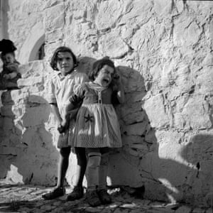 Two girls exhibit different reactions to a raised camera, Bonefro, Italy, 1946