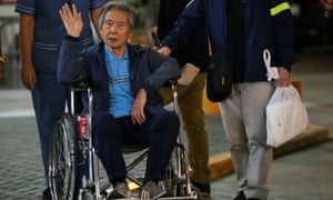 Peru's former president Alberto Fujimori being wheeled out of a Lima hospital on 4 January where he received a Christmas Eve pardon from former president Pedro Pablo Kuczynski.