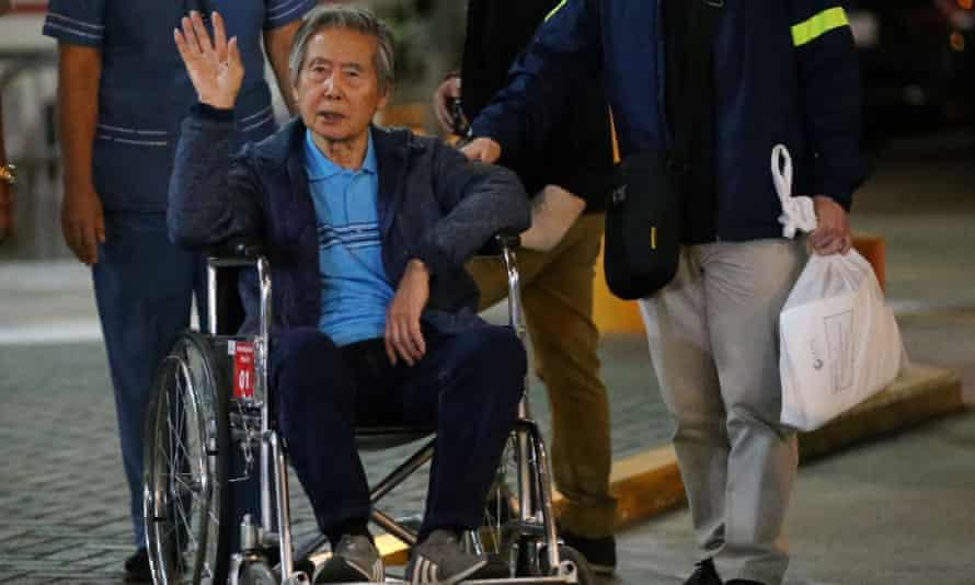 Peru's former president Alberto Fujimori being wheeled out of a Lima hospital on 4 January where he received a Christmas Eve pardon from former president Pedro Pablo Kuczynski.