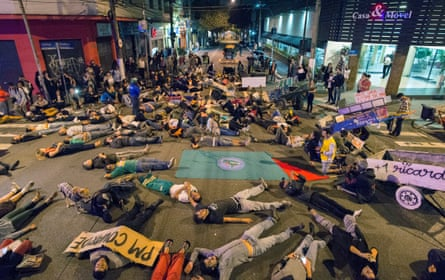 Protesters stage a die-in in Pinheiros, São Paulo.
