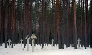 Wooden posts at Sandormokh with photographs and names of victims