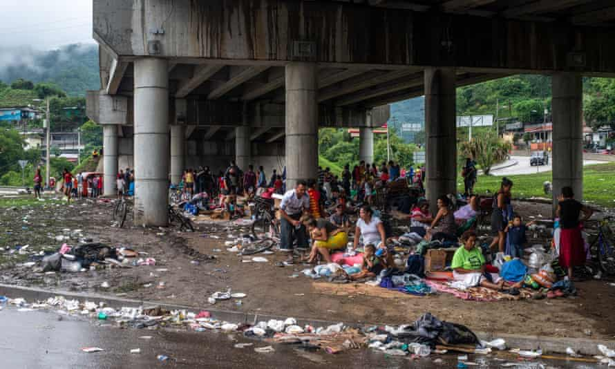 People who were forced to abandon their homes in the in the aftermath of Hurricane Eta take refuge in a makeshift camp underneath an overpass.