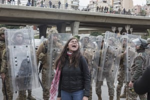 Beirut, Lebanon A protester chants in front of security forces as anti-government demonstrators attempt to block politicians from accessing parliament ahead of a vote of confidence in the new government