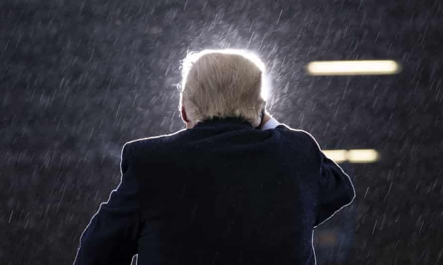 Donald Trump<br>President Donald Trump speaks in the rain during a campaign rally at Capital Region International Airport in Lansing Mich., on Oct. 27, 2020. (AP Photo/Evan Vucci)