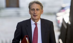 Philip Hammond hails news that Britain's economy grew in the last quarter, but some economists fear a Brexit recession looming