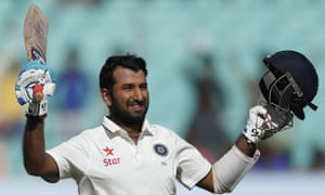 Cheteshwar Pujara celebrates his century on the third day of the first Test against England in Rajkot.