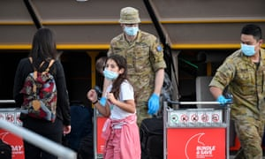 Passengers arrive at Sydney international airport off a Qatar Airways flight on 1 May about to board coaches which will take them into hotel quarantine. Gabriela D'Souza says purpose-built quarantine is the best way to keep Australia Covid normal.