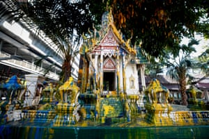 Bangkok, Thailand. Paint covers a Buddhist shrine inside the Royal Thai police headquarters the morning after anti-government protests