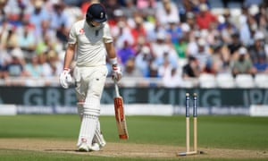 England's Joe Root surveys the damage after being bowled by Chris Morris of South Africa.