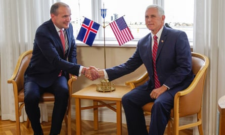 Iceland's president, Guðni Jóhannesson, shakes hands with Mike Pence in Hofdi House in Reykjavik