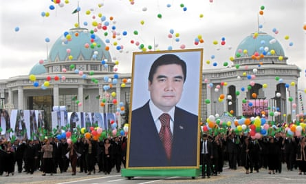 Citizens carry a picture of Turkmen president Gurbanguly Berdimuhamedov through Ashbagat, a city where political dissent is not allowed.