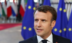 The French president, Emmanuel Macron in front of EU flags