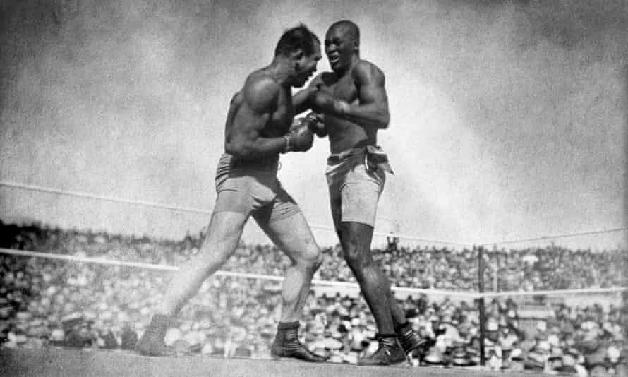 Jim Jeffries (left) takes on Jack Johnson during the 'Fight of the Century' in 1910. Jeffries would later contract, and recover from, the Spanish flu
