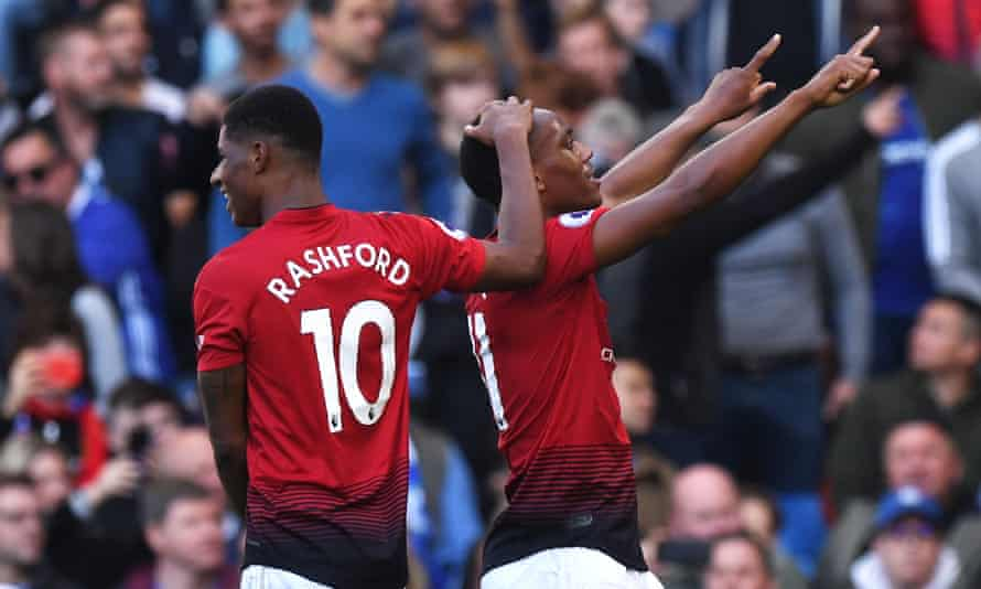 Anthony Martial and Marcus Rashford celebrate the French striker's first goal against Chelsea.