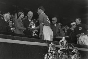 The Blackpool captain, Harry Johnston, shakes the hand of the Queen before receiving the trophy.