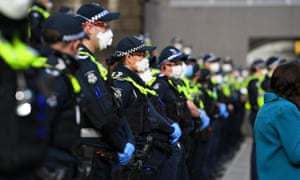 Victoria police officers stand guard ahead of the Black Lives Matter rally in Melbourne